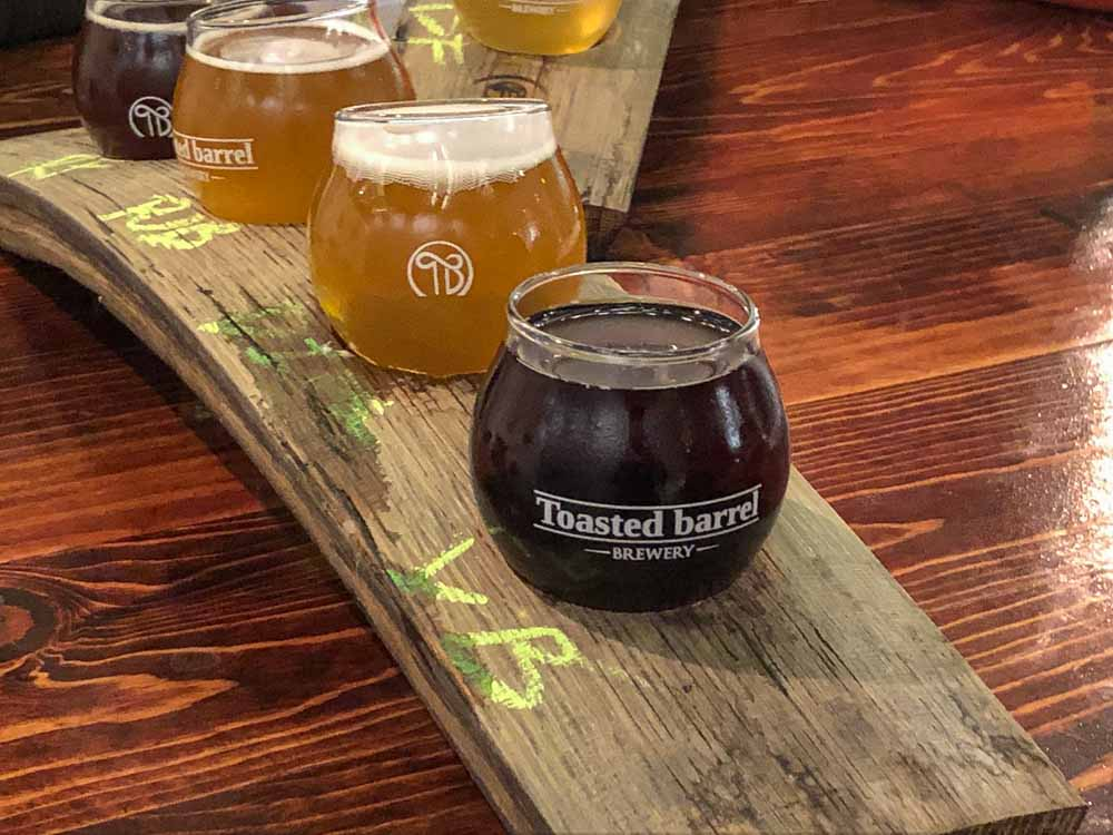 SLC Breweries: Toasted Barrel Brewery. Beer sampler on a wooden board