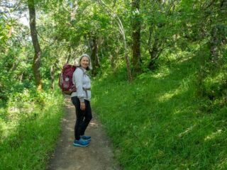 El Camino de Santiago packing list- hiker with pack in forest