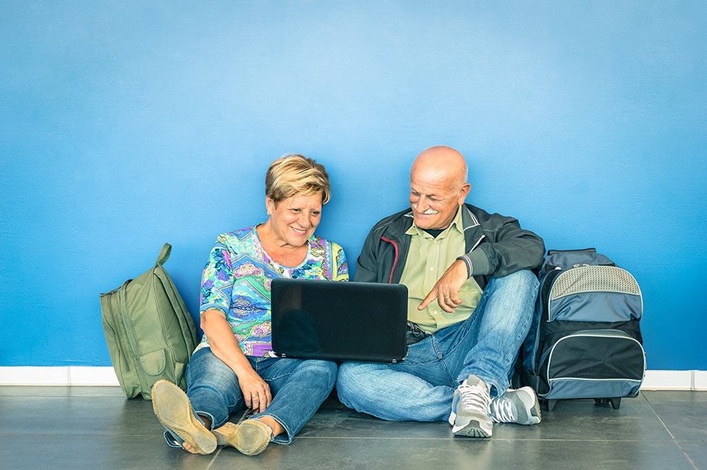 VPN protect data while traveling. Man and woman with luggage