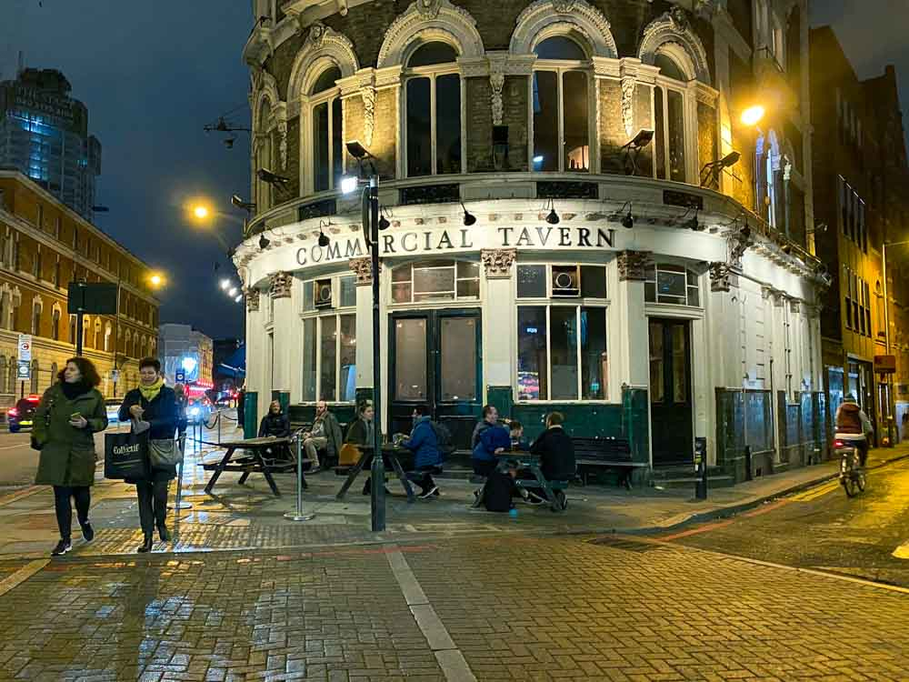 Shoreditch Pubs: Commercial Tavern. Street scene with pub and tables