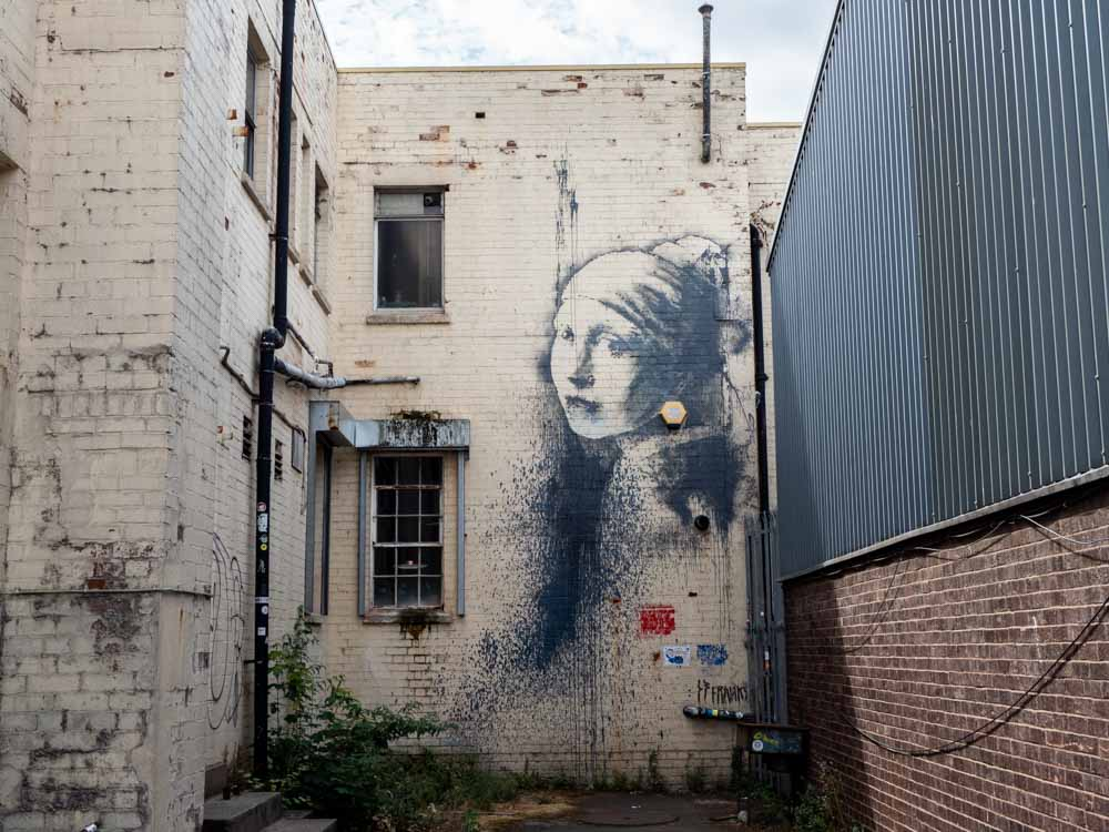 Banksy Bristol stencil girl with the pierced eardrum