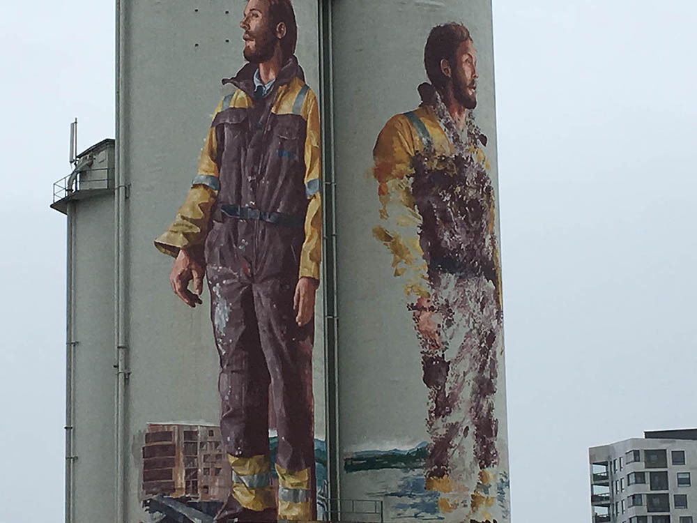 Best street art city: Stavenger Norway mural by Fintan Magee. Silo street art
