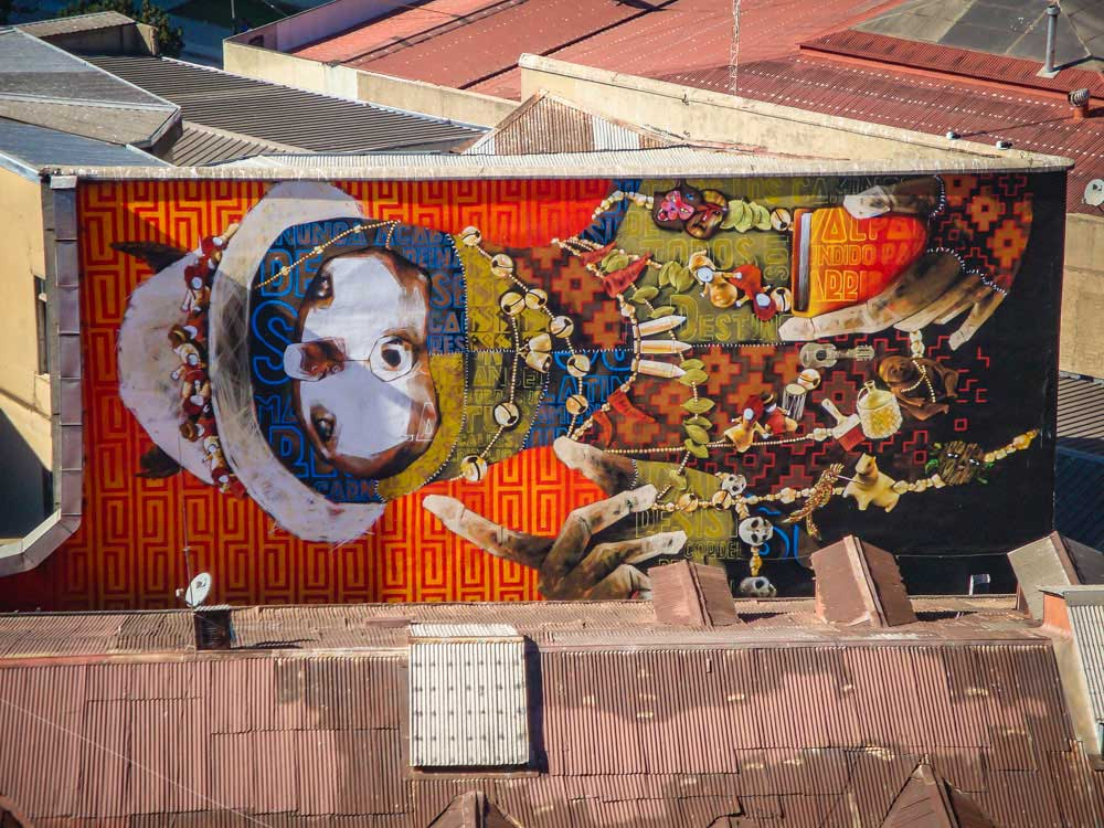 Cool street art in Valparaiso: by Inti Castro. Orange mural