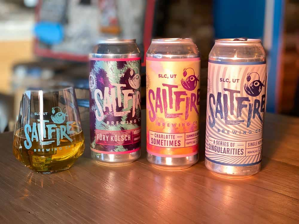 Saltfire brewing Salt Lake. Cans and a glass of beer