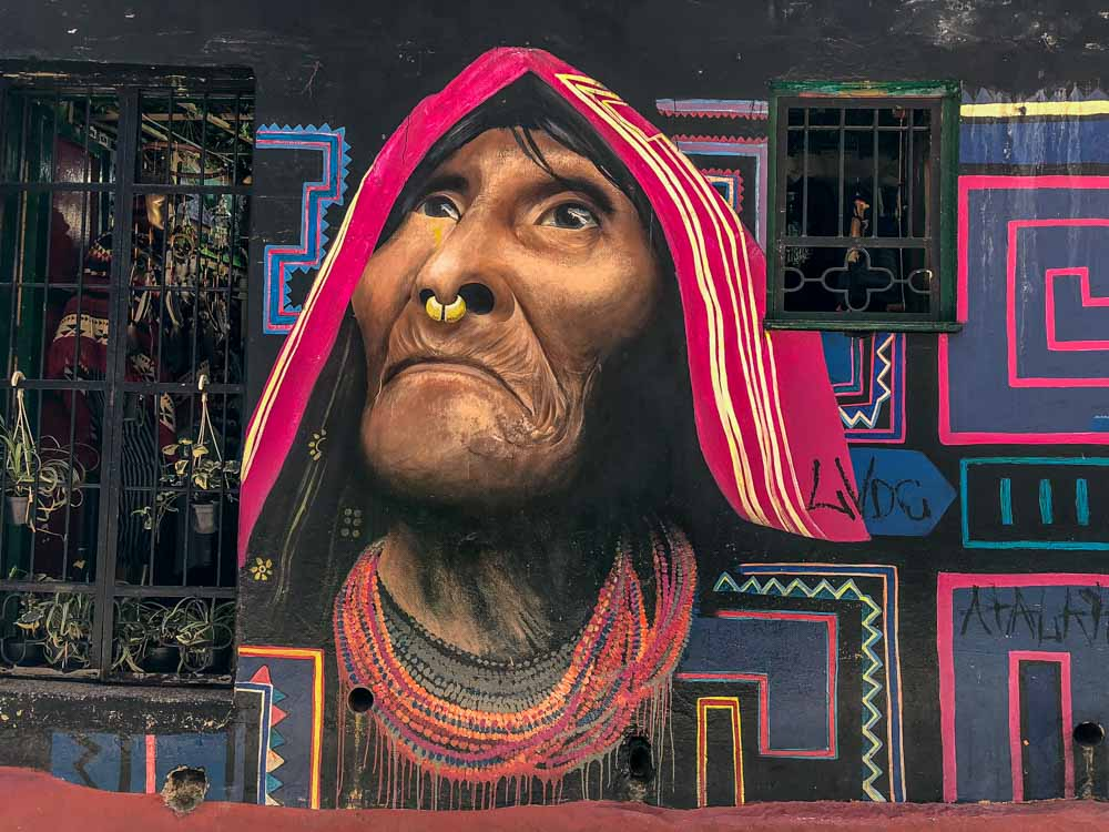 Street art Bogota- mural by Carlos Trilleras. Indigenous woman wearing a scarf and nose ring