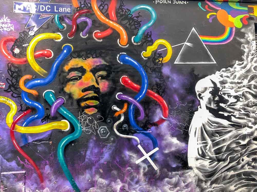 Melbourne Australia: Jimi Hendrix mural in ACDC Lane - with portrait and blue, purple and red tubes