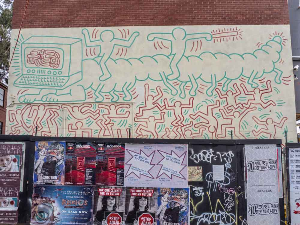 Keith Haring mural in Melbourne's Collingwood. Green and red characters