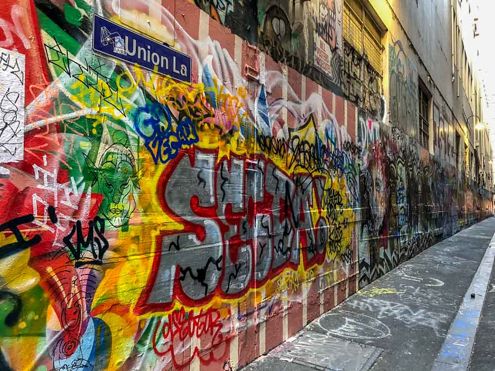 Graffiti Melbourne: Union Lane. Red and yellow lettering