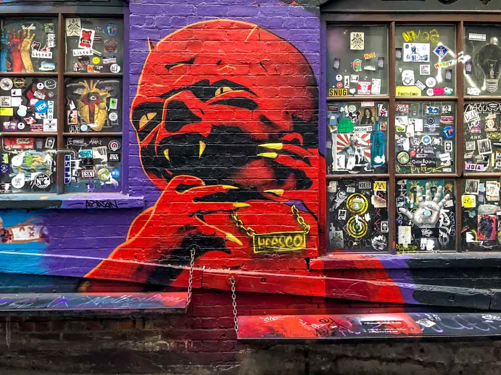 Heesco mural in melbourne. Red monster with purple background