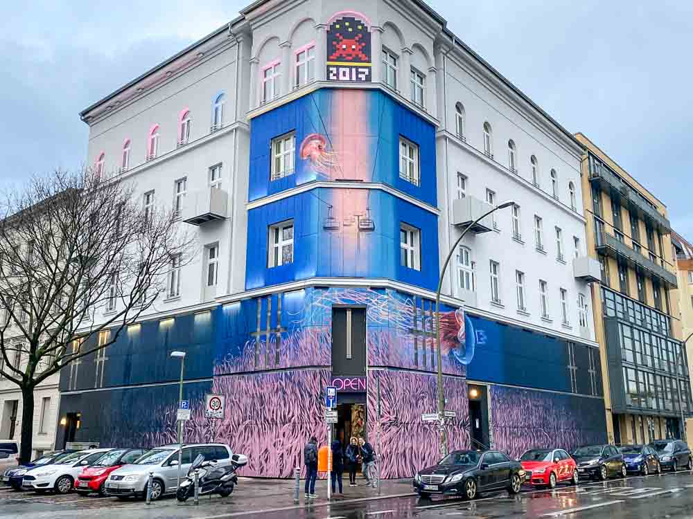 Berlin Urban Nation street art museum. building with blue and pink mural