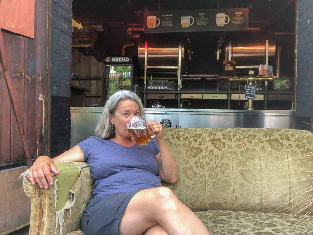 Berlin Bergit and Bier beer garden- woman sitting on a couch drinking beer