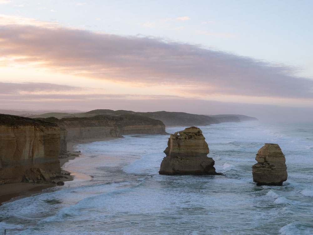 Great Ocean Road itinerary: 12 Apostles at dawn. Limestone stacks with coastal cliffs and clouds