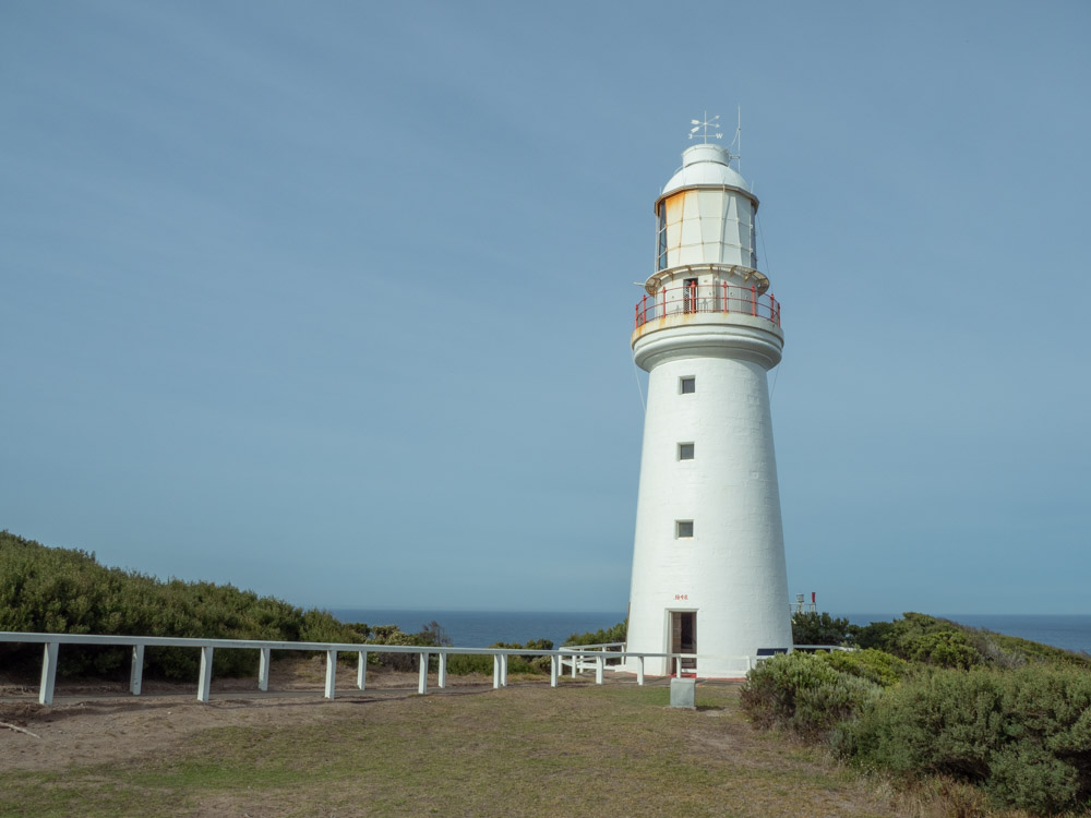 Cape Otway lighthouse on the Great Ocean Road. White lighthouse with walkway and fencing
