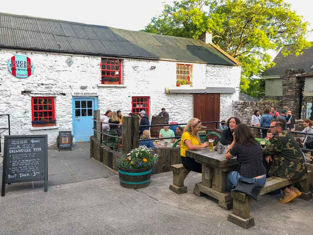 Dick Mac brewery in DIngle Ireland. People on a patio drinking beer