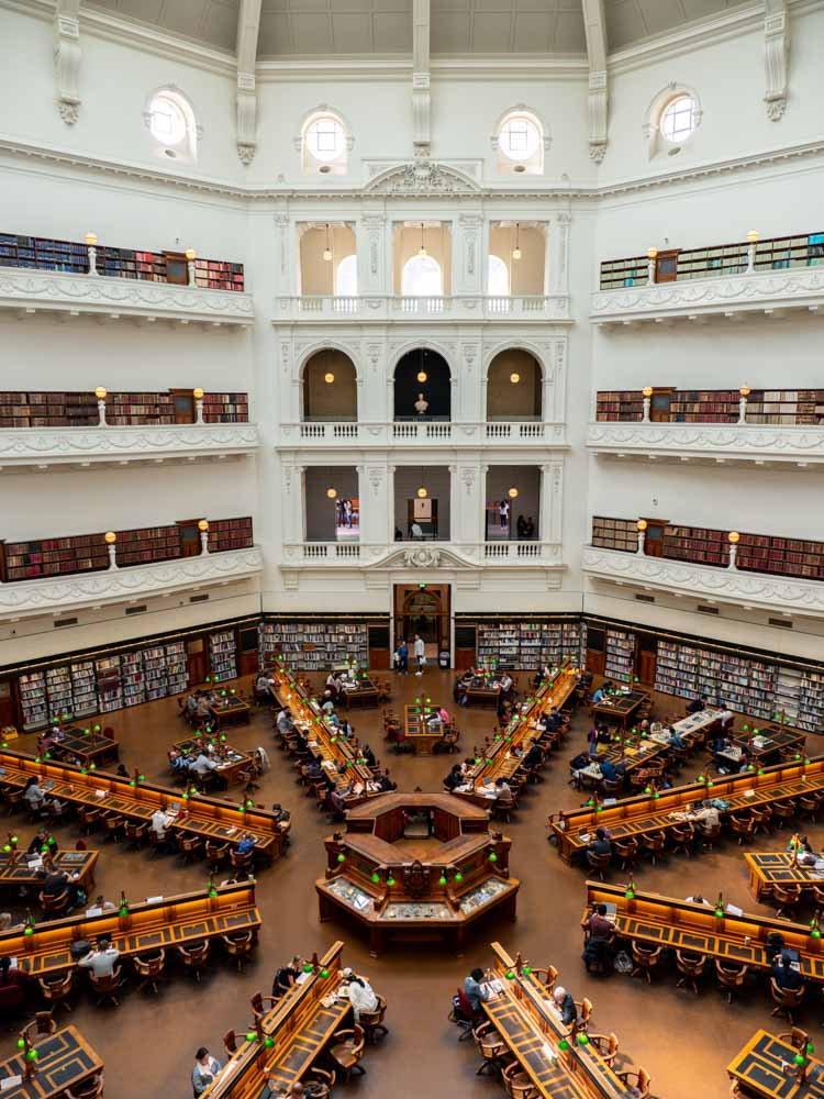 Beautiful libraries: Australia Melbourne central library. rotunda and reading tables in a large room