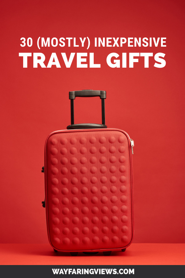 Useful small and nexpensive travel gifts. red suitcase with red background