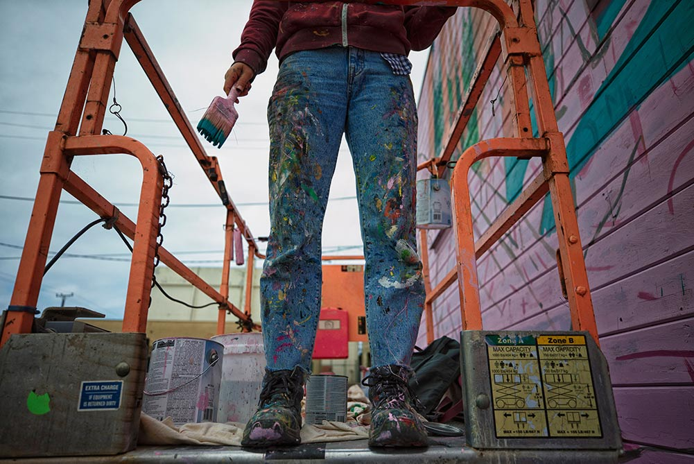 Eureka California street art festival. Legs and painted jeans on scaffolding