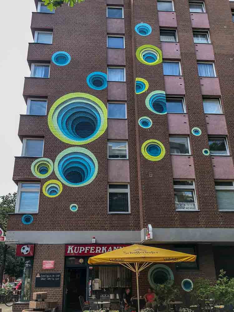1010 mural in Berlin Shoenberg. blue and green circles
