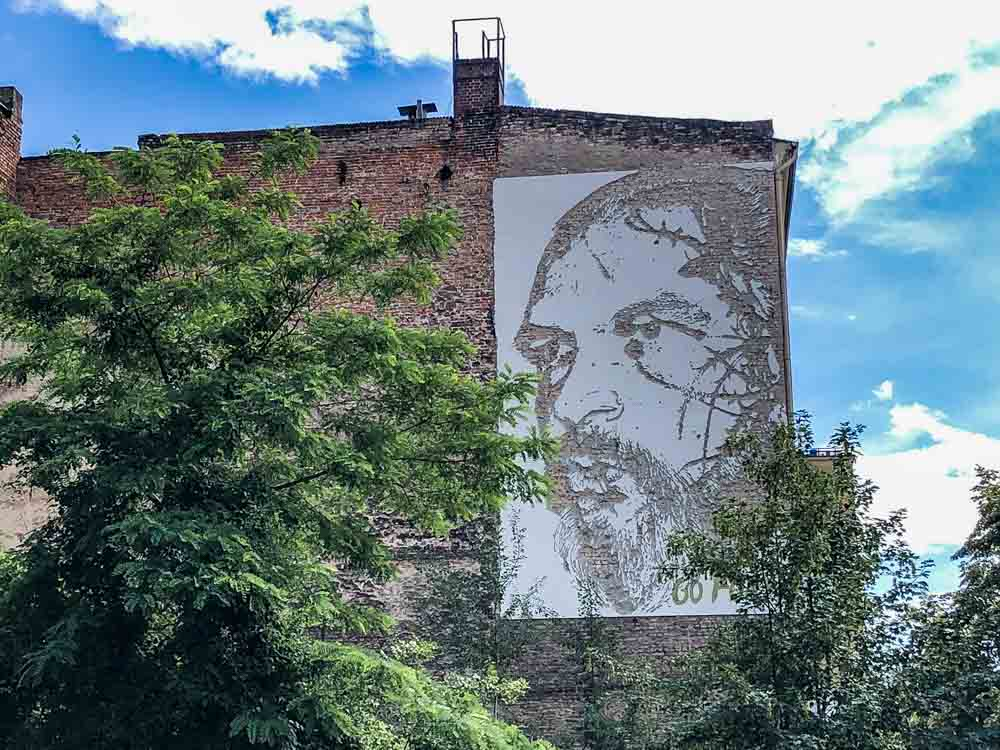 Vhils mural in Berlin- Go Forth