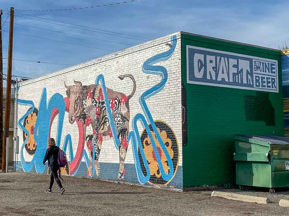 Craft Beer and Wine mural by Nanook in Reno Nevada. Mural with woman walking