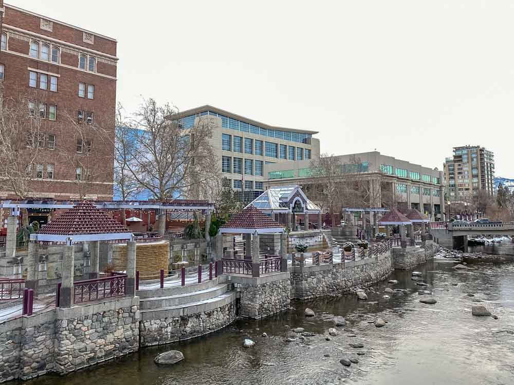 Reno Nevada Riverwalk District in winter. River and buildings with snow