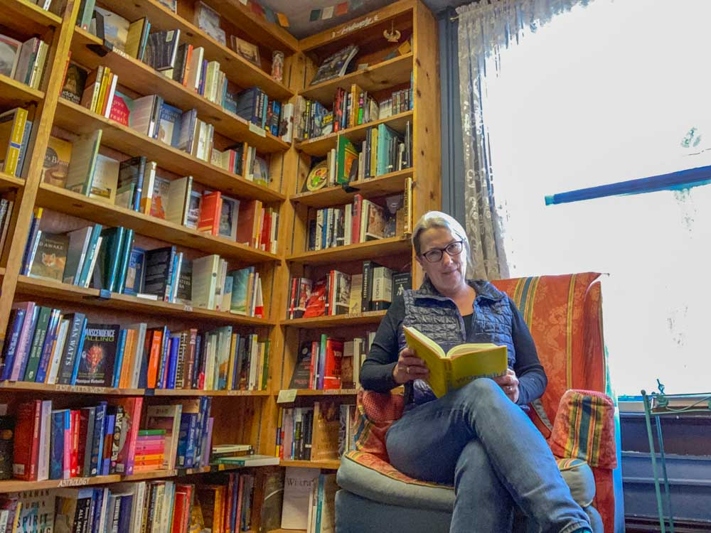 Sundance Bookstore in Reno. Bookshelves and woman reading