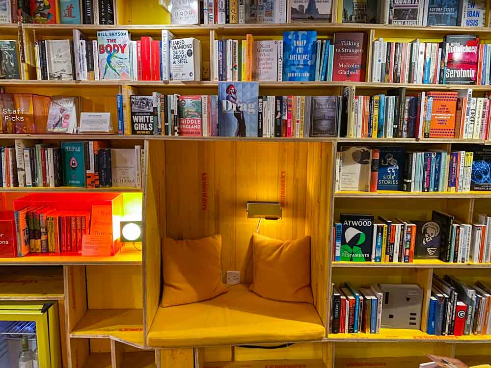 Libreria Bookstore in Shoreditch London. books with bench, pillows and lighting