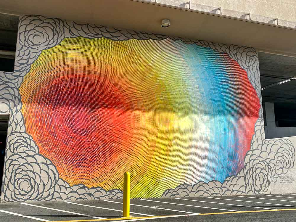 Ascholz mural in Honolulu for POW!WOW! Swirl design with red yellow and blue