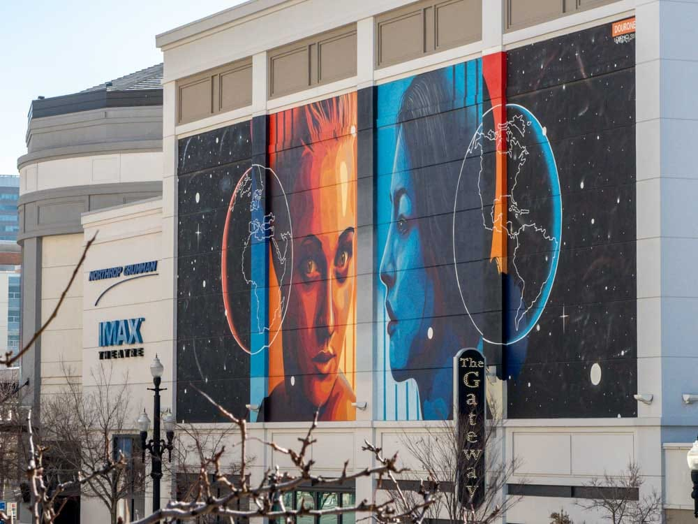 Salt Lake City Gateway center mural by dourone. Two Faces Earth. blue and orange