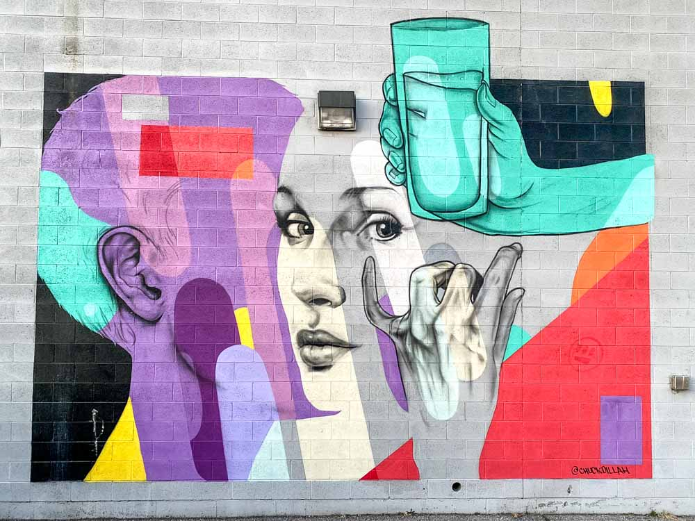 Chuck Dillah Mural in Salt Lake CIty. Face with water glass