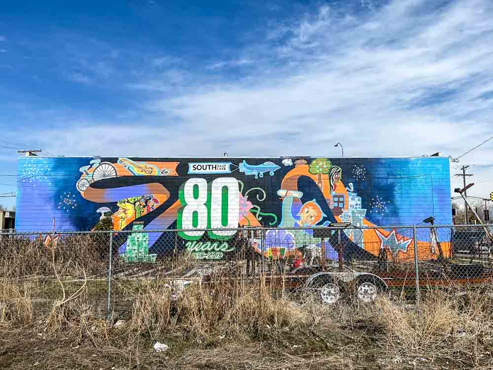 South Salt Lake City street art 80 years: mural and weeded lot