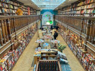 Bookshops in London: Daunt Books Marlybone. Victorian bookstore interior.